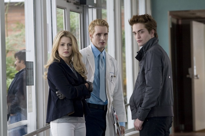 Nikki Reed as Rosalie Hale, Peter Facinelli as Carlisle Cullen, and Robert Pattinson as Edward Cullen in the 2008 American romantic fantasy film Twilight