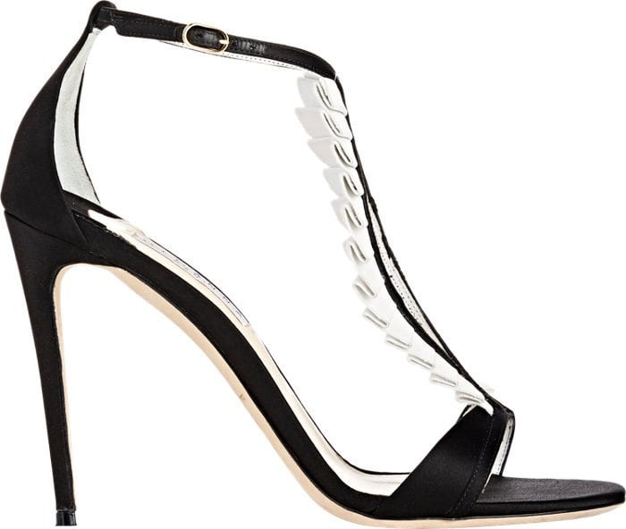 The pin-thin stiletto heel and open-toe front are complemented by contouring straps that are trimmed with white leather pleats – a detail inspired by the classic dress shirt