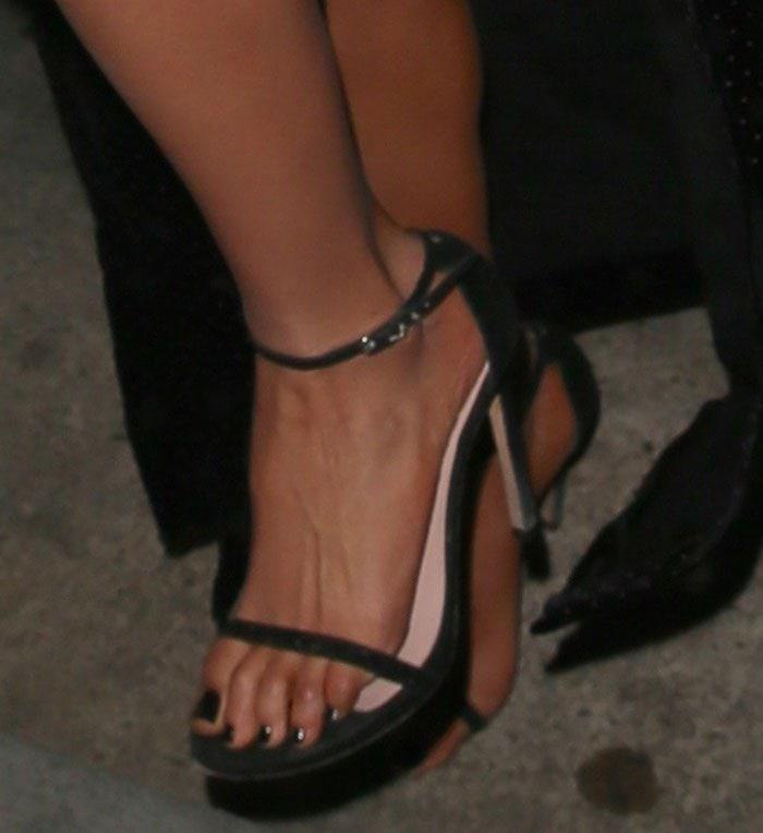 Olivia Culpo shows off her feet in Stuart Weitzman sandals