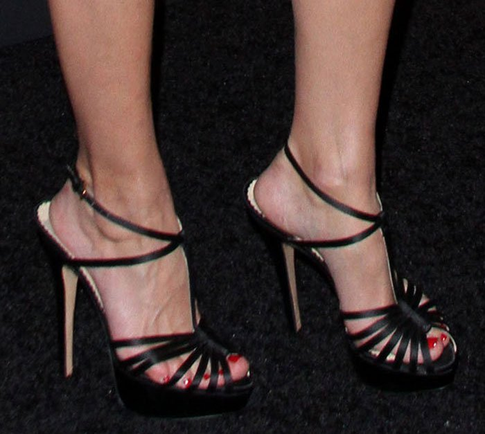Olivia Palermo's feet in strappy black Charlotte Olympia sandals
