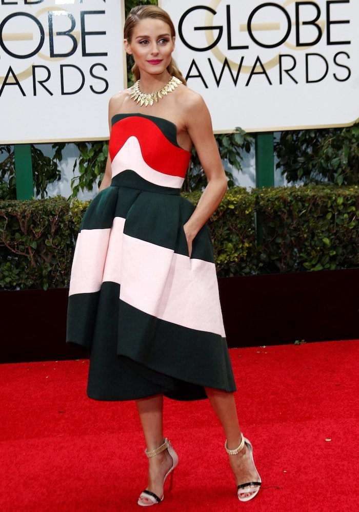 Olivia Palermo adds several inches of height with two-tone ankle-strap sandals