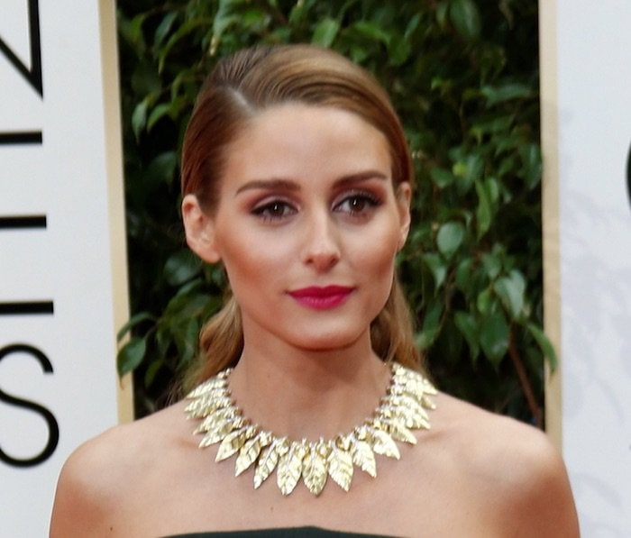Olivia Palermo accessorizes with a gold leaf-shaped David Webb necklace