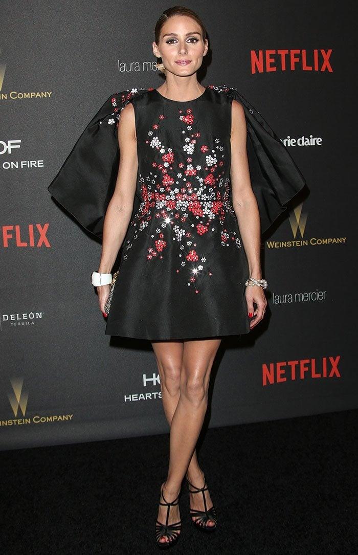 Olivia Palermo shows off her legs in a sleeveless black dress from Giambattista Valli
