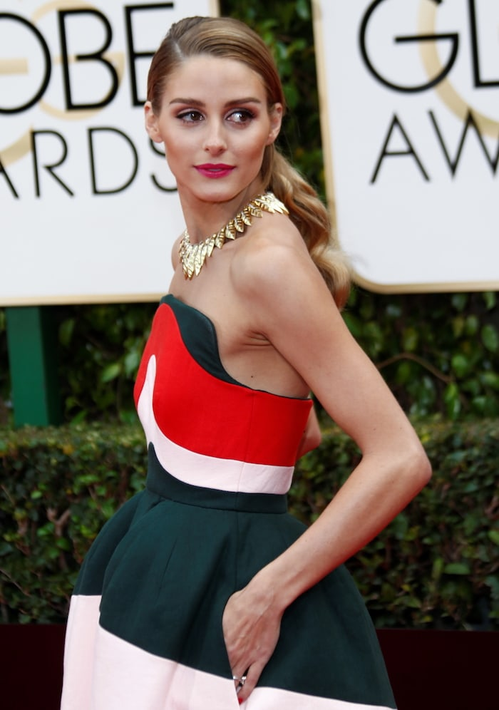 Olivia Palermo wears a striped Delpozo gown at the Golden Globes