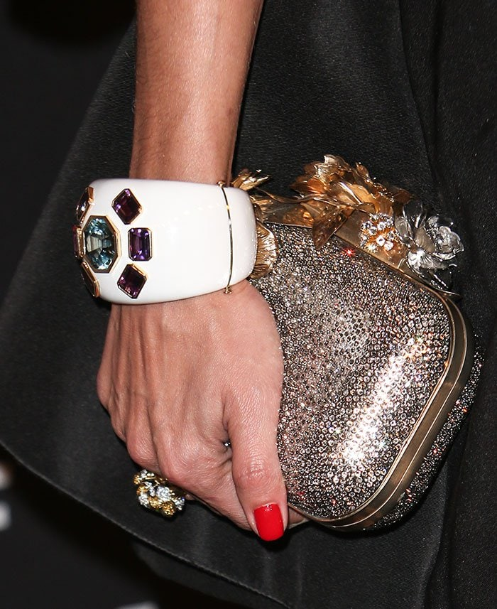 Olivia Palermo holds a sparkling Jimmy Choo clutch