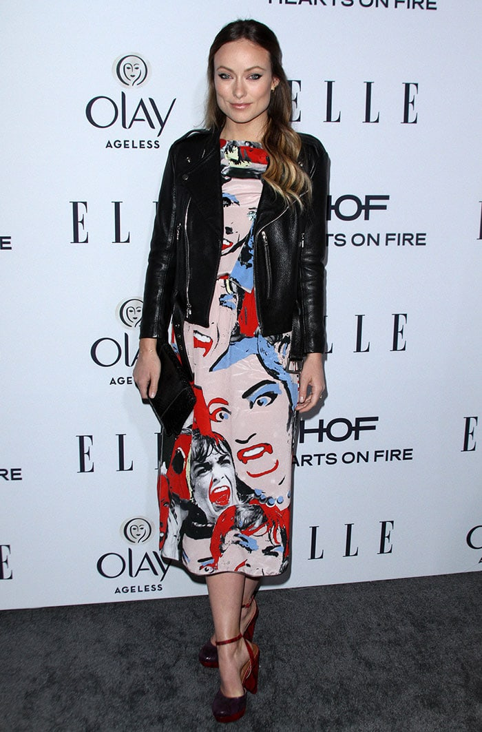Olivia Wilde wears a leather jacket over a pop-art-printed Marc Jacobs dress