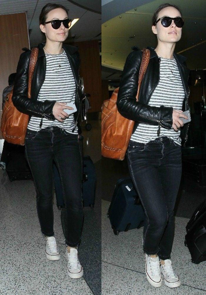 Olivia Wilde wears her hair back as she departs Los Angeles International Airport