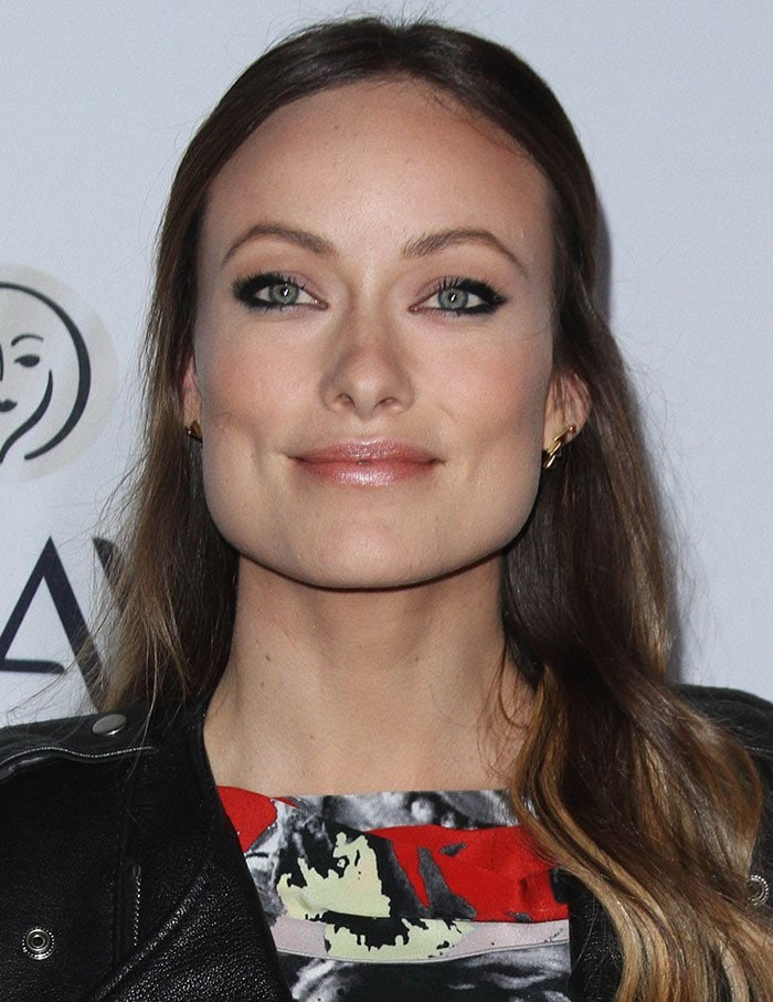 Olivia Wilde wears her hair half-up and half-down at Elle's Women In Television Celebration presented by Hearts on Fire Diamonds and Olay