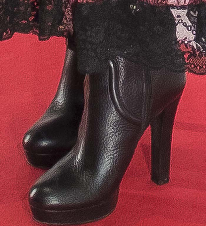 Penelope Cruz wears a pair of platform ankle boots on the red carpet