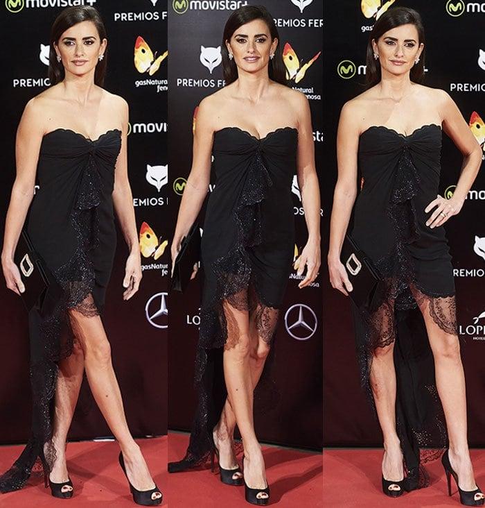 Penelope Cruz flaunts her legs and shoulders in a black Emanuel Ungaro dress