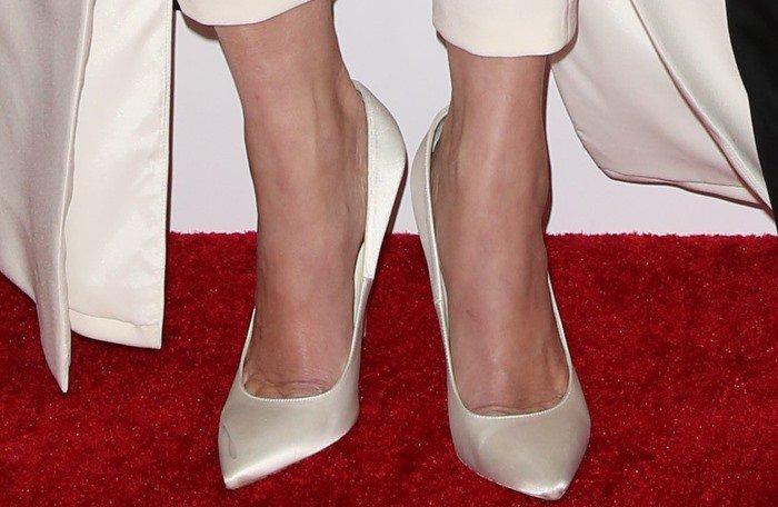 Portia de Rossi's feet in white satin Brian Atwood pumps
