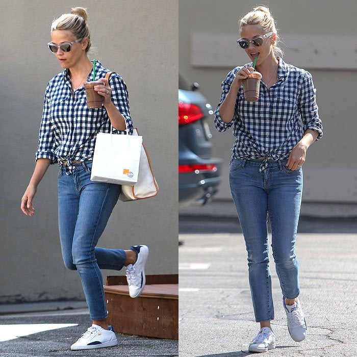 Reese Witherspoon wears white sneakers with a country-chic checked shirt