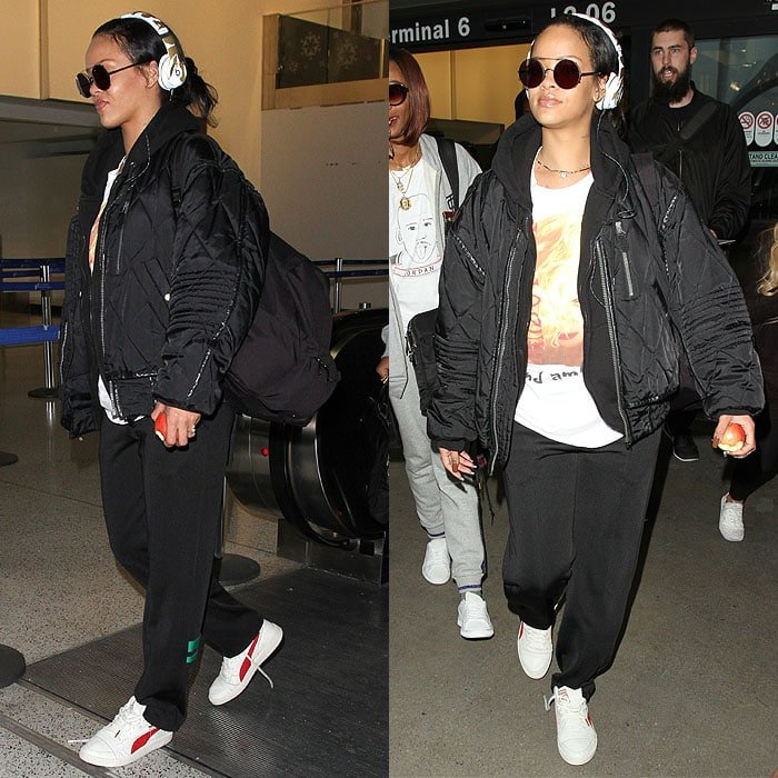 Rihanna wears white sneakers with a hoodie and sweatpants