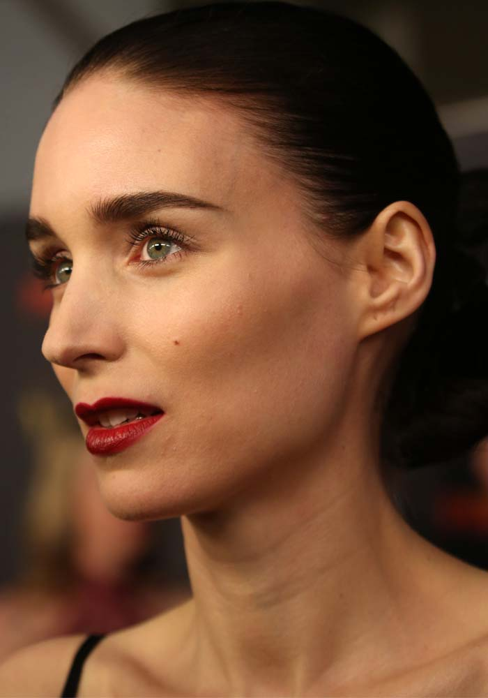 Rooney Mara wears simple eye makeup and dark lipstick on the AACTA red carpet