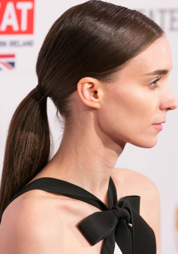 Rooney Mara wears her hair back in a simple ponytail