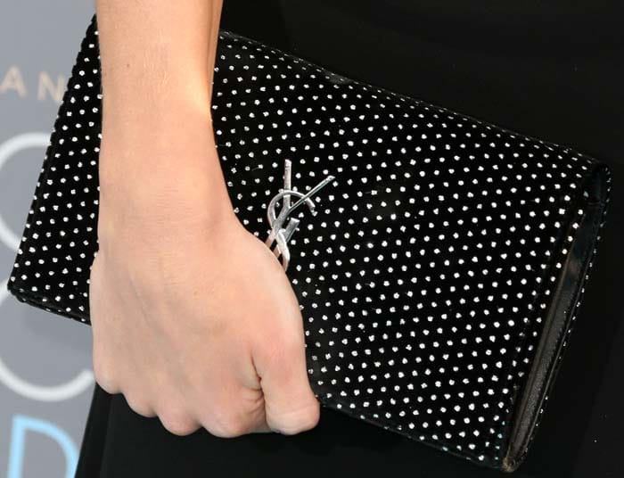 Rosie Huntington-Whiteley holds her Yves Saint Laurent clutch