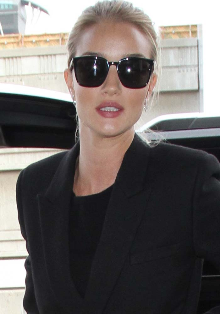 Rosie Huntington-Whiteley wears her hair back as she arrives at Los Angeles International Airport