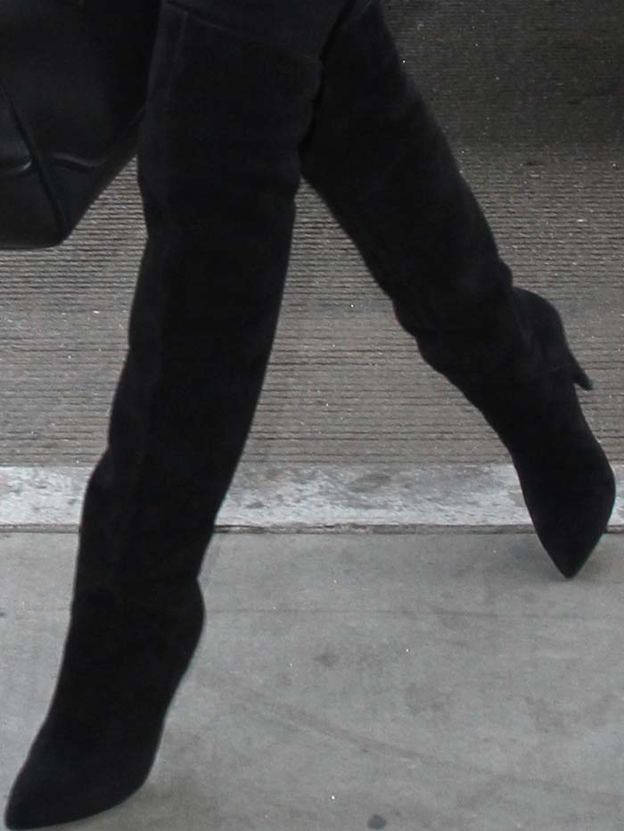 Rosie Huntington-Whiteley wears a pair of Saint Laurent over-the-knee boots