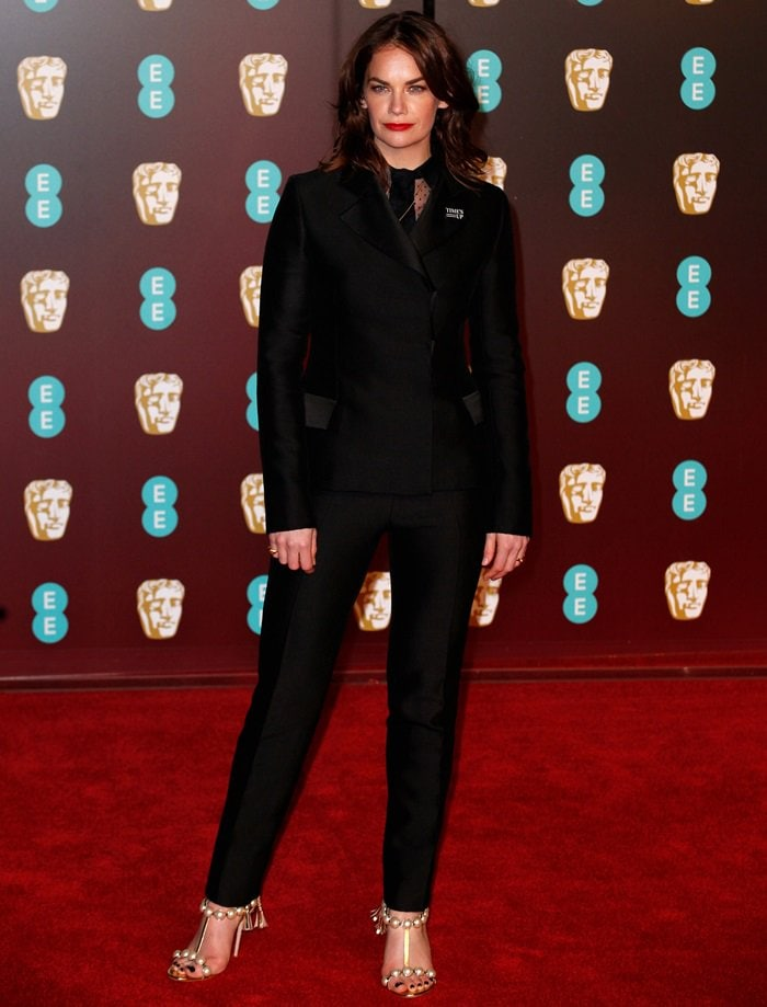 Ruth Wilson in a black bar tuxedo suit from the Christian Dior Spring 2018 Haute Couture  collection and a point d'espirit shirt