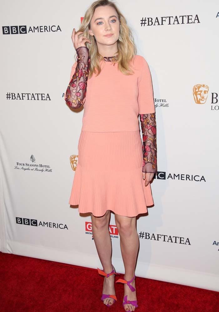 "Saoirse turned heads in a peach Lela Rose dress and two-toned Alexandre Birman ""Lolita"" bow sandals at the BAFTA Los Angeles Awards Season Tea at Four Seasons, Los Angeles on January 9, 2016"
