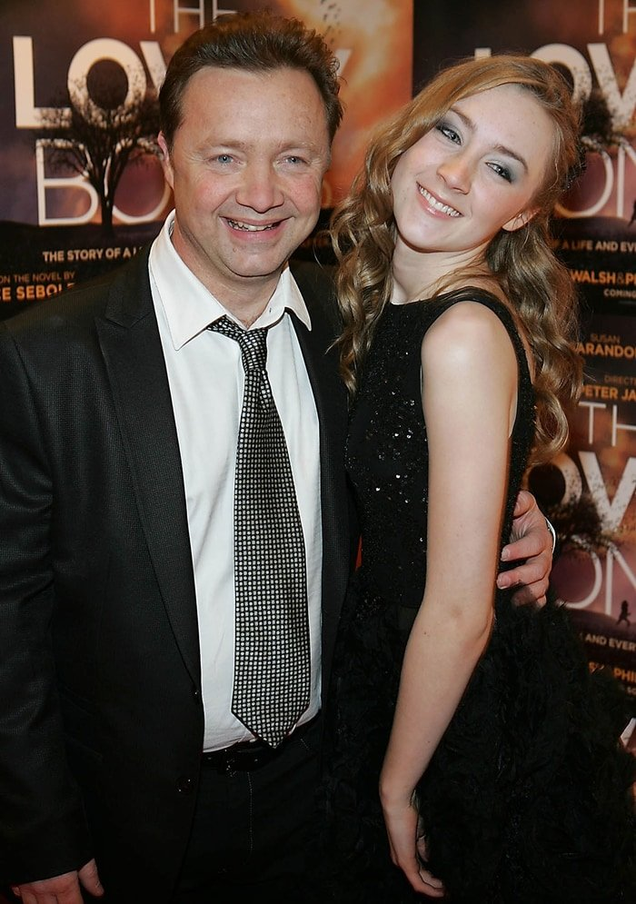 Saoirse Ronan posing with her father Paul Ronan at the Irish premiere of The Lovely Bones