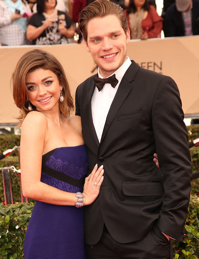 Sarah Hyland and boyfriend Dominic Sherwood pose for photos on the red carpet