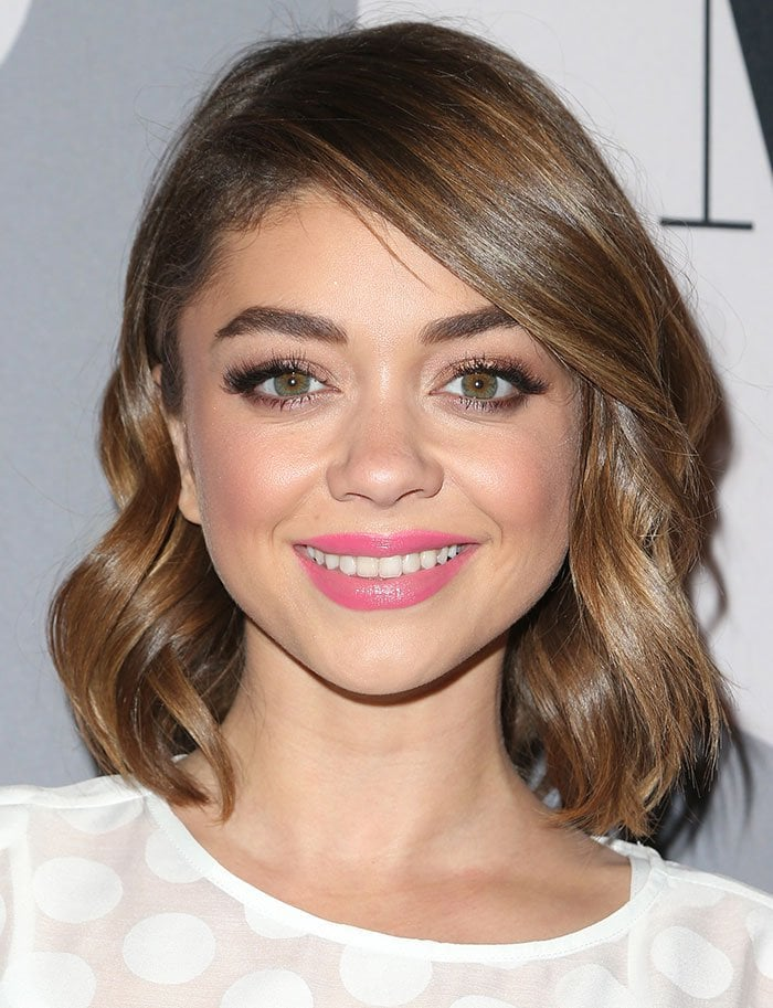 Sarah Hyland curls her hair for the Minnie Rocks The Dots Art And Fashion Exhibit with Refinery 29