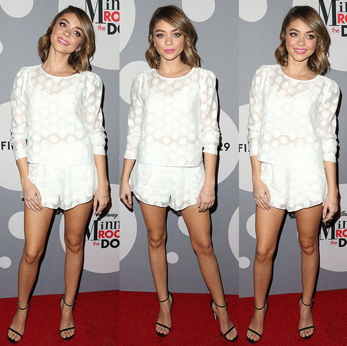 Sarah Hyland wears a white polka-dotted set at the Minnie Mouse Rocks The Dots Art And Fashion Exhibit