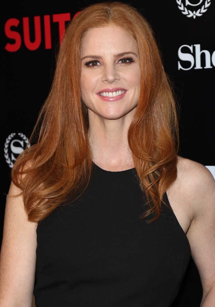 """Sarah Rafferty wears her red hair down at the Season 5 premiere of USA Network's """"Suits"""""""
