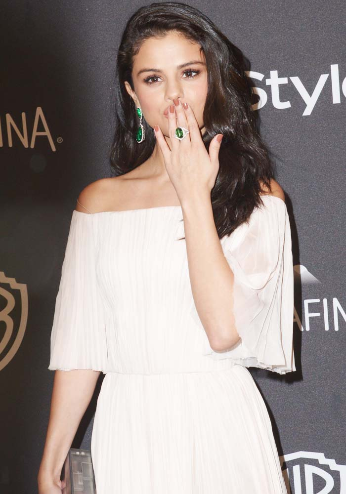 Selena Gomez paired the dress with unapologetic emerald green earrings and a matching ring from Jacob & Co