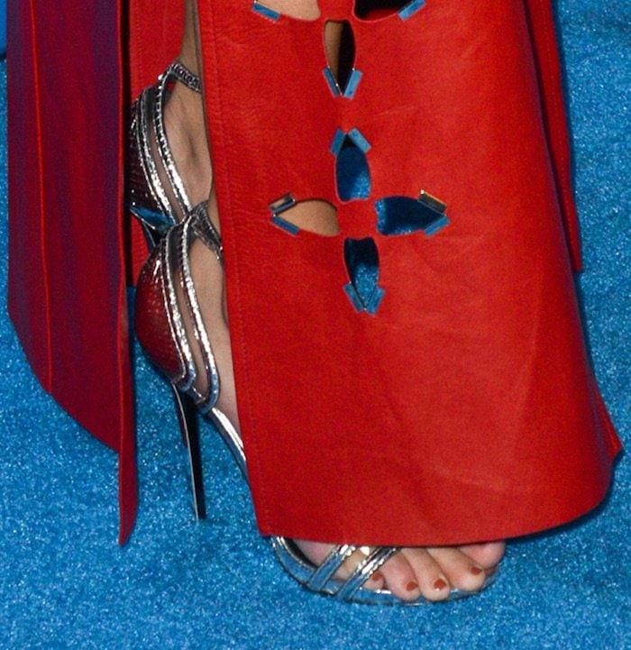 Selena Gomez's feet in strappy silver Louis Vuitton sandals
