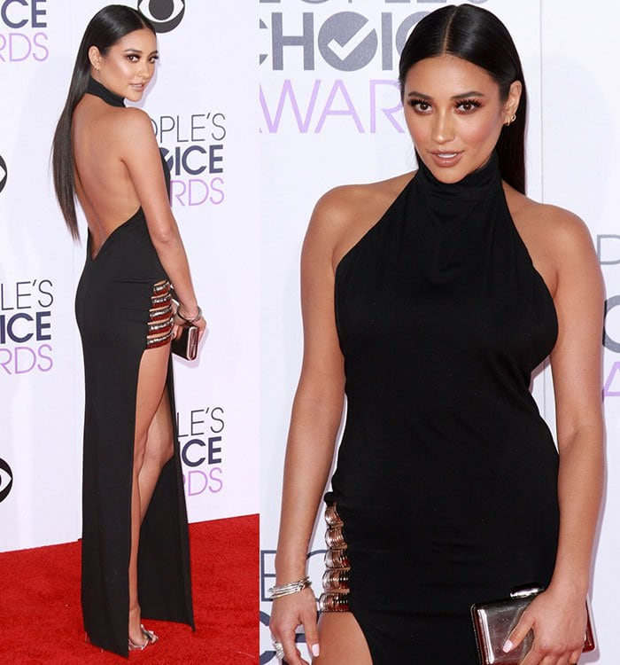 Shay Mitchell wearingher long raven locks sleek straight from a center part