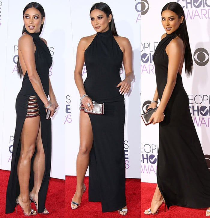 Leggy Shay Mitchell ina long black halter-neck gown by Haney