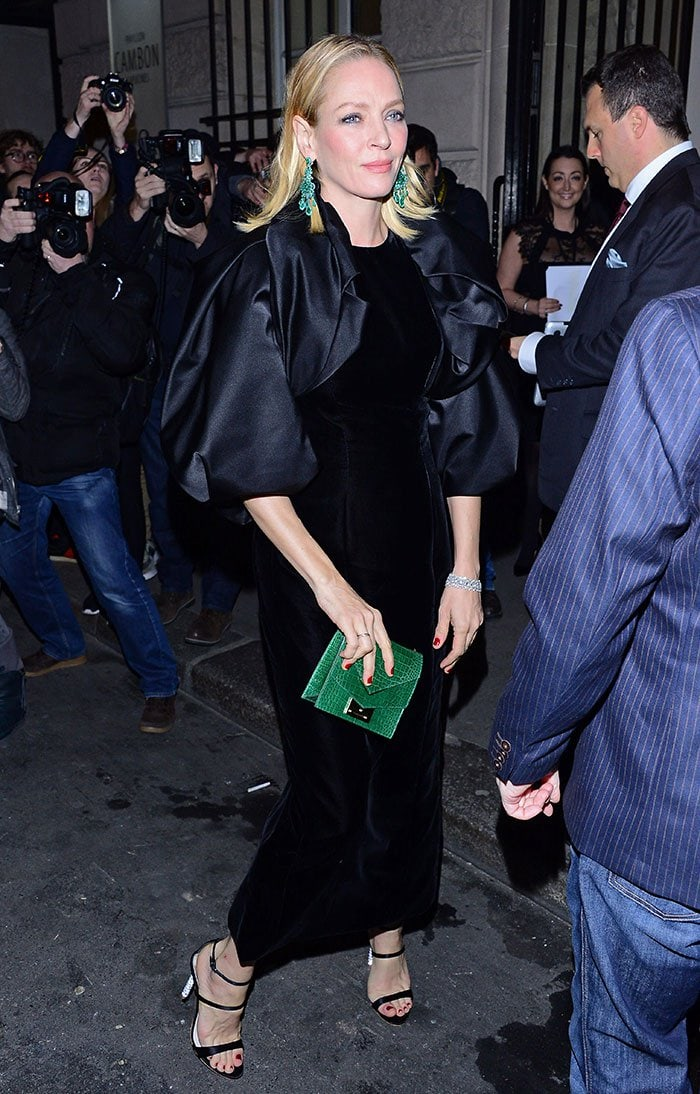 Uma Thurman wears her hair down at Paris Fashion Week