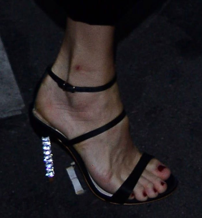 "Uma Thurman's feet in strappy ""Rosalind"" sandals"