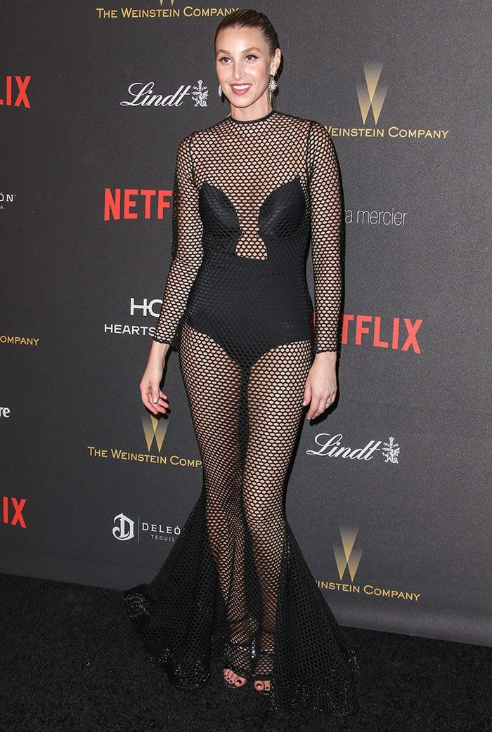 Whitney Port shows off a lot of skin and a black bodysuit in a mesh gown
