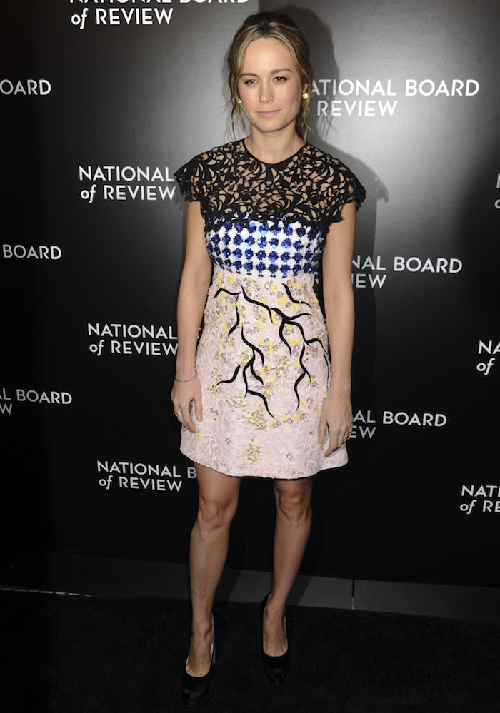 Brie Larson's Giambattista Valli dress features black lace, blue sequins and an embroidered beige skirt