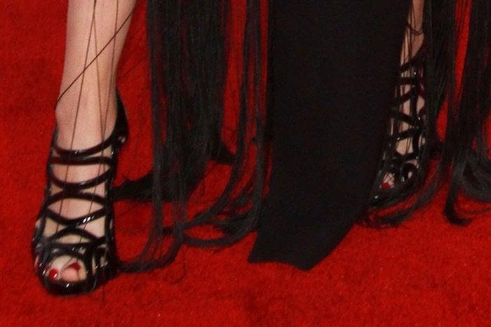 Katie Stevens's feet in Alexandre Birman caged sandals