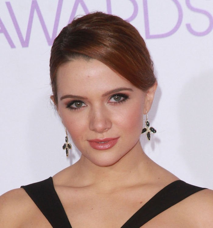 Katie Stevens wears her red hair back at the 2016 People's Choice Awards