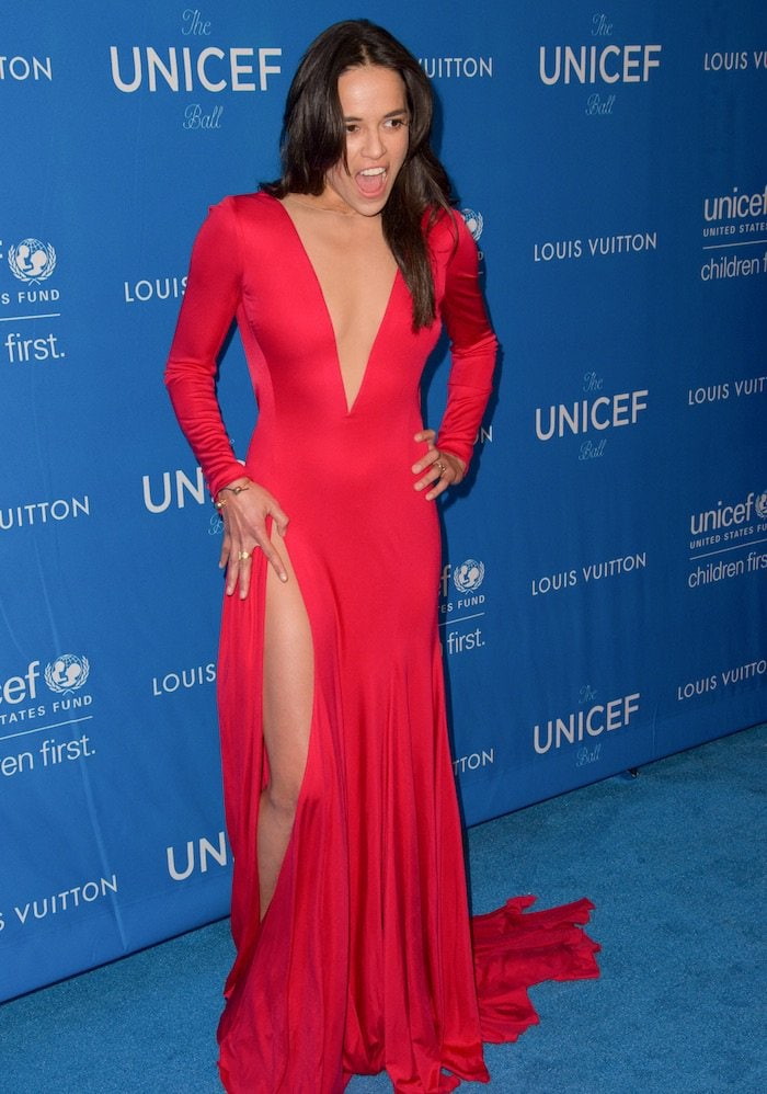 Michelle Rodriguez's sexy dress features a plunging V neckline