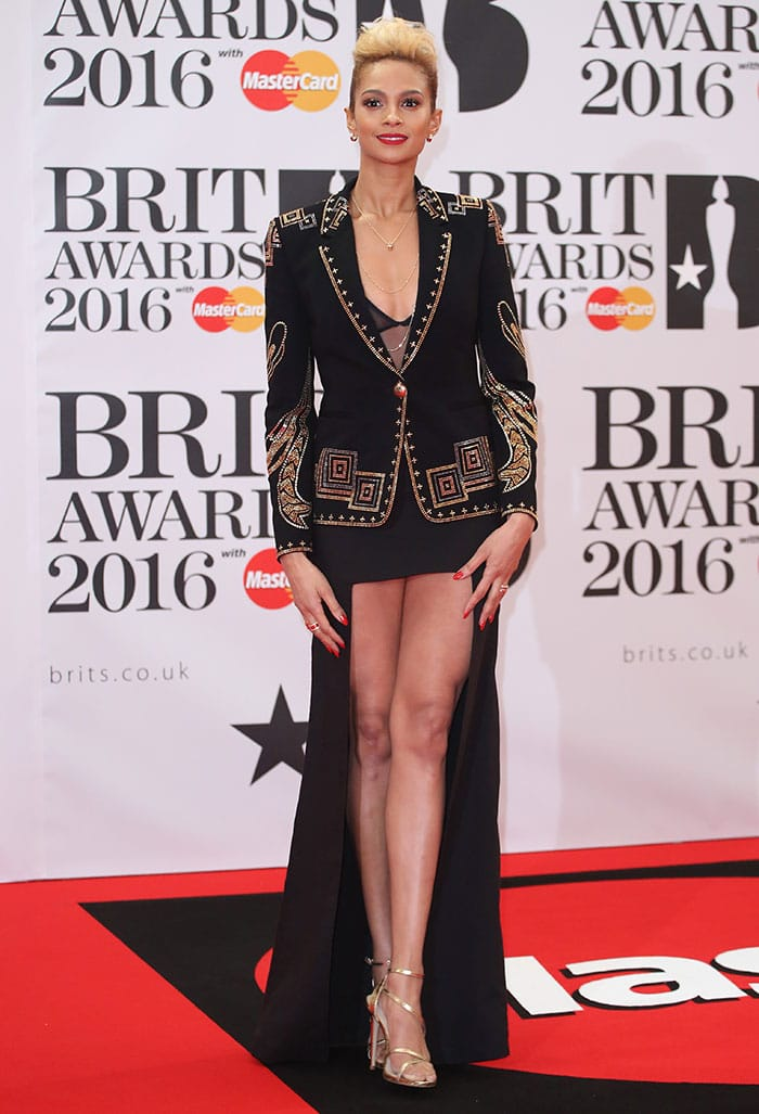 Alesha Dixon shows off her legs in a plunging sheer top and a high-low skirt