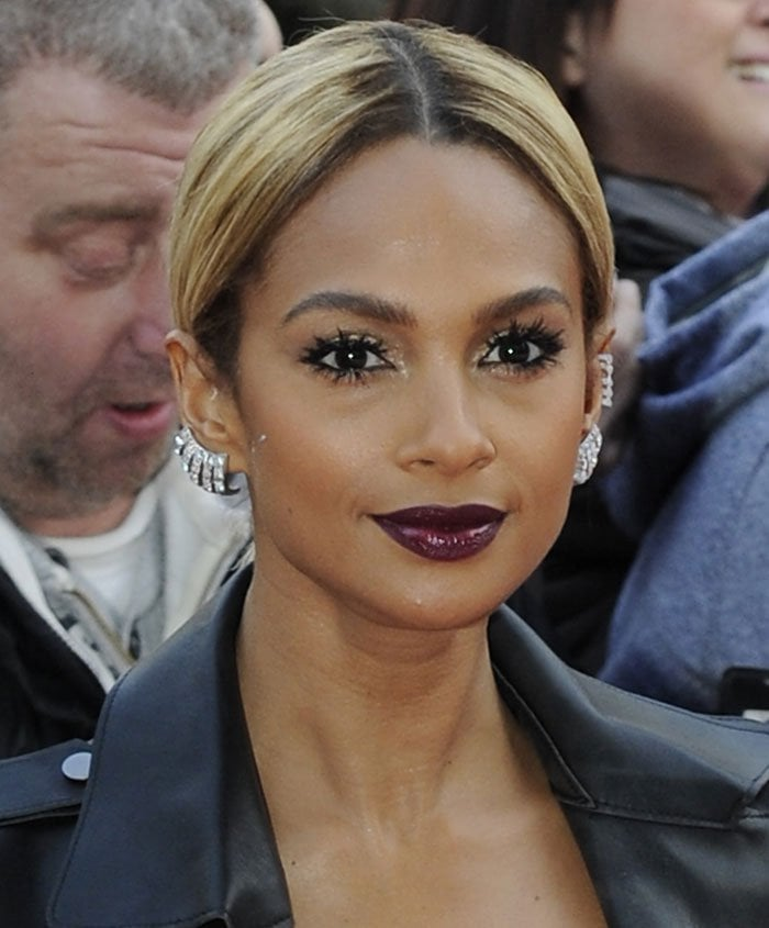 Alesha Dixon wears plum lipstick and dramatic eyelashes