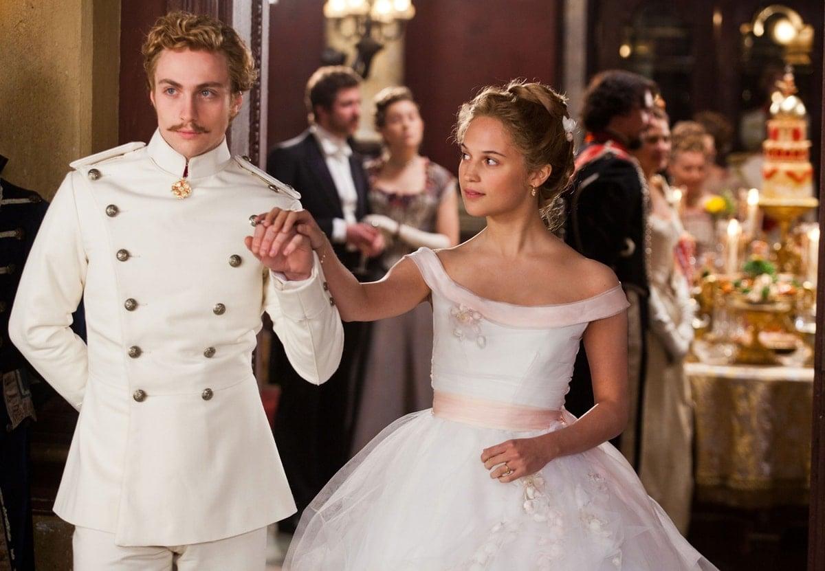 "Aaron Taylor-Johnson as Count Alexei Kirillovich Vronsky and Alicia Vikander as Princess Ekaterina ""Kitty"" Alexandrovna Shcherbatskaya in Anna Karenina"