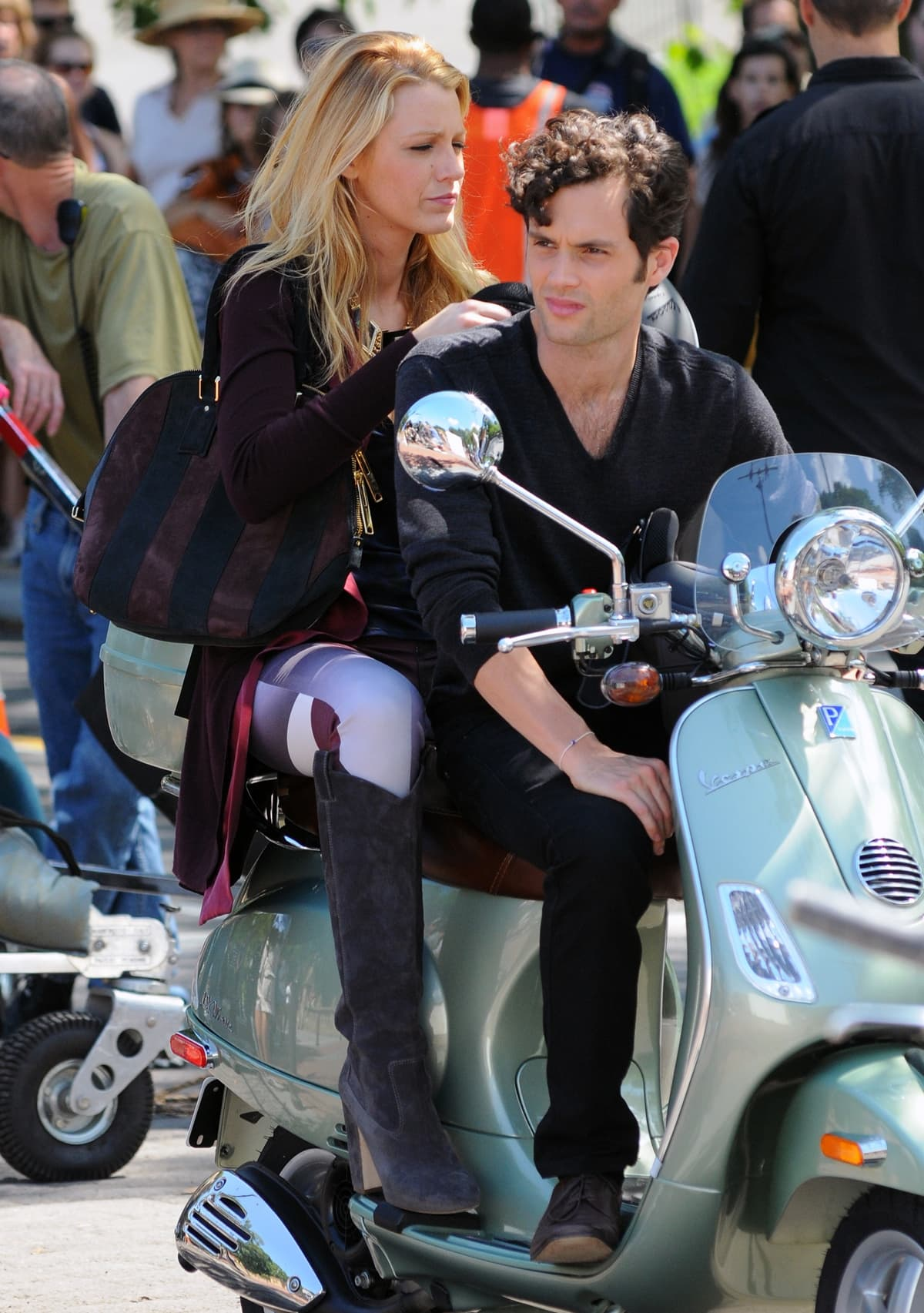 Blake Lively and Penn Badgley ride a Vespa scooter on the set of Gossip Girl in Central Park in New York City
