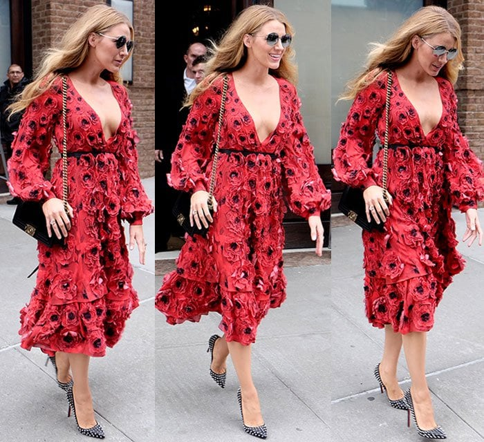 Blake Lively carries a Chanel purse and wears a large pair of sunglasses while strolling through New York City