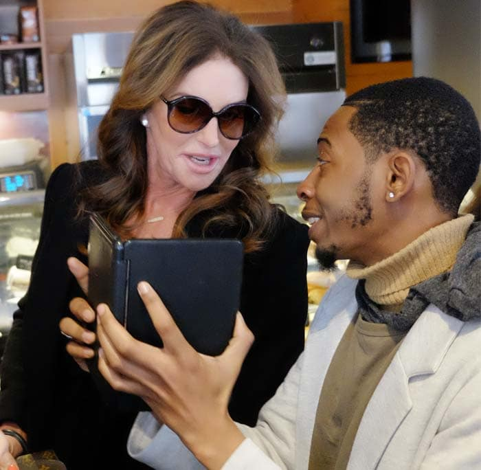 Caitlyn Jenner chats with a fan at a Starbucks in New York City