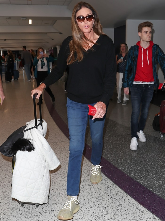 Caitlyn Jenner rocks blue jeans at LAX International Airport