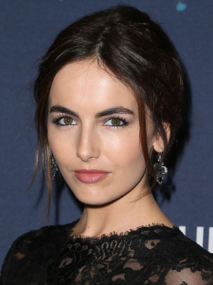 Camilla Belle wears her hair in a chic updo at the 3rd annual Unite4:Humanity event