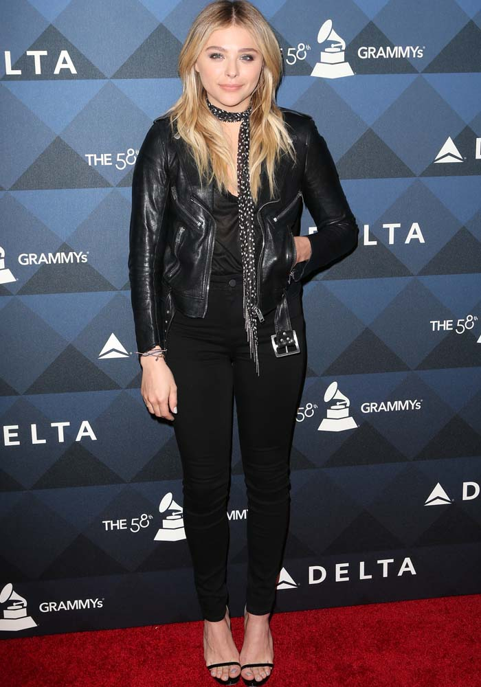 Chloe Moretz wears an all-black look with a leather jacket on the red carpet