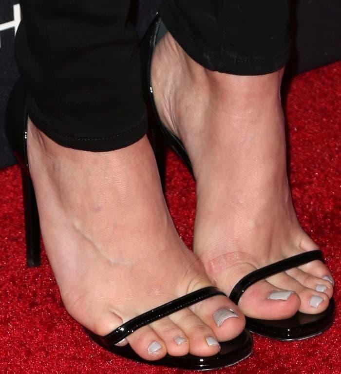 Chloe Moretz's feet in strappy black Saint Laurent sandals